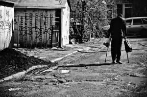 hospitalcubano 300x199 A sick poor man with crutches walking down the street