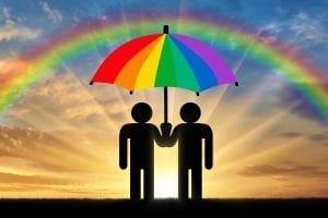 glbt 300x200 Two gay men under a rainbow umbrella
