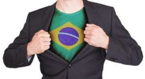 brazilrevol e1521655278787 300x163 Businessman opening suit to reveal shirt with flag