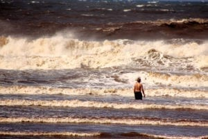 drowning 300x200 Lone Boy Standing in Sea