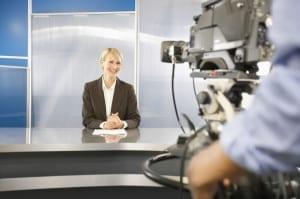 MP900431033v 300x199 Newscaster in Television Studio